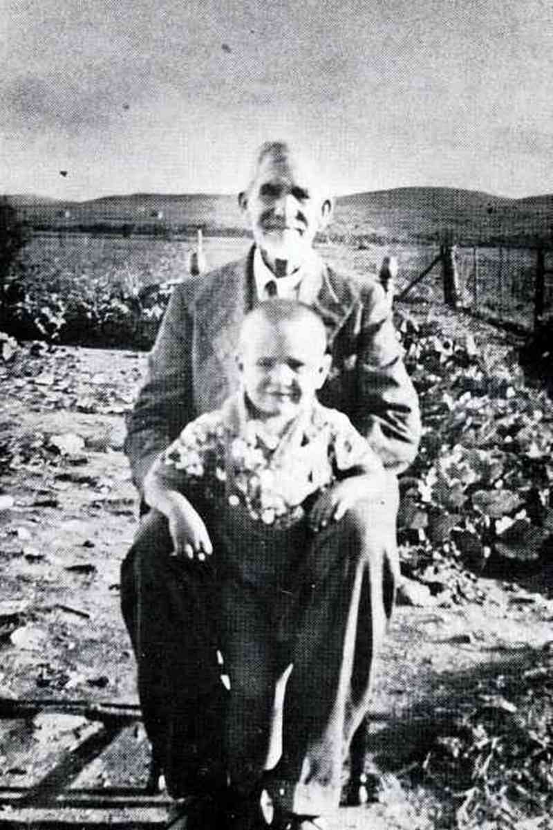 "A very young Breyten Breytenbach with his father (I think?). Photo from ""'n Seisoen in die Paradys."" No caption in the book."