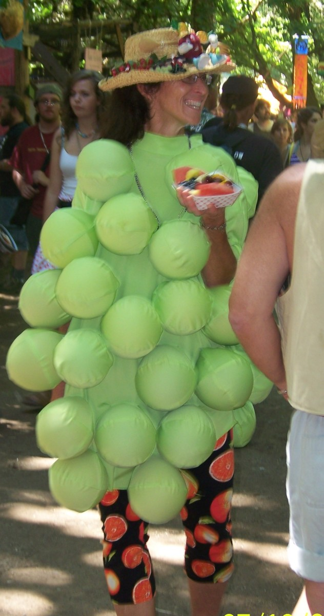 Where else will you see a bunch of grapes eating fruit?