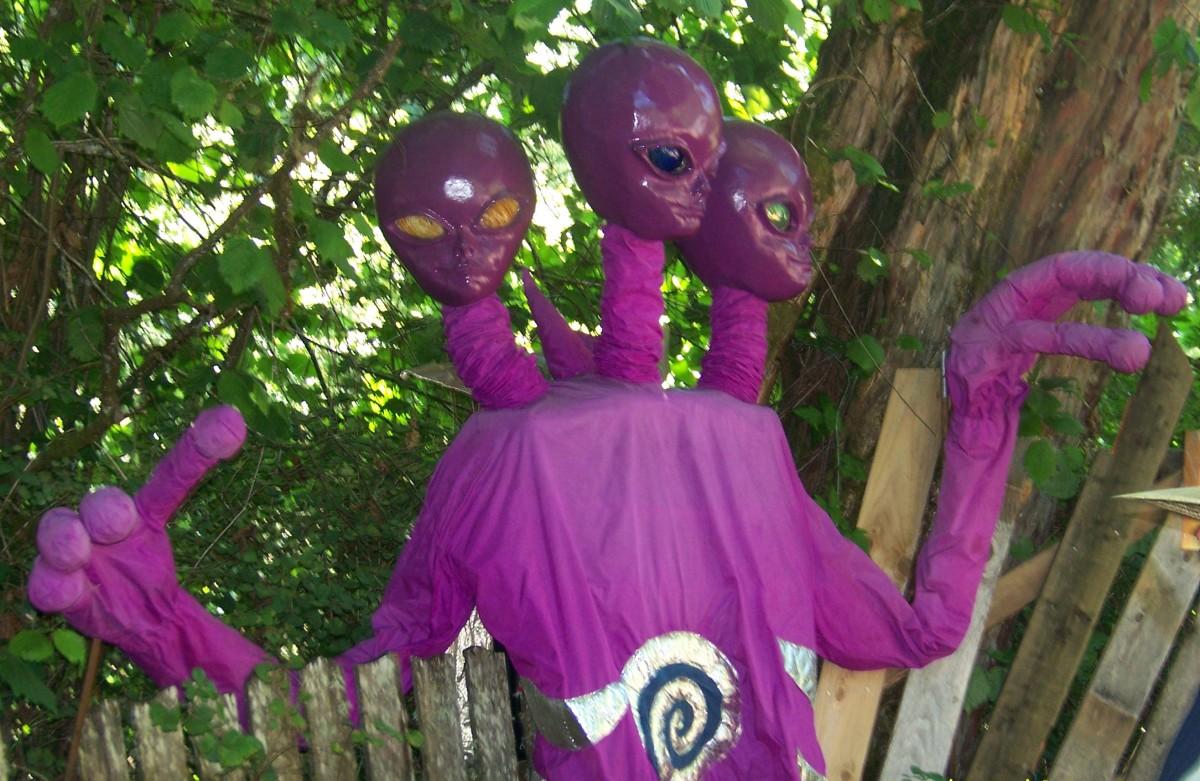 12-foot tall three-headed aliens walk among the crowd.