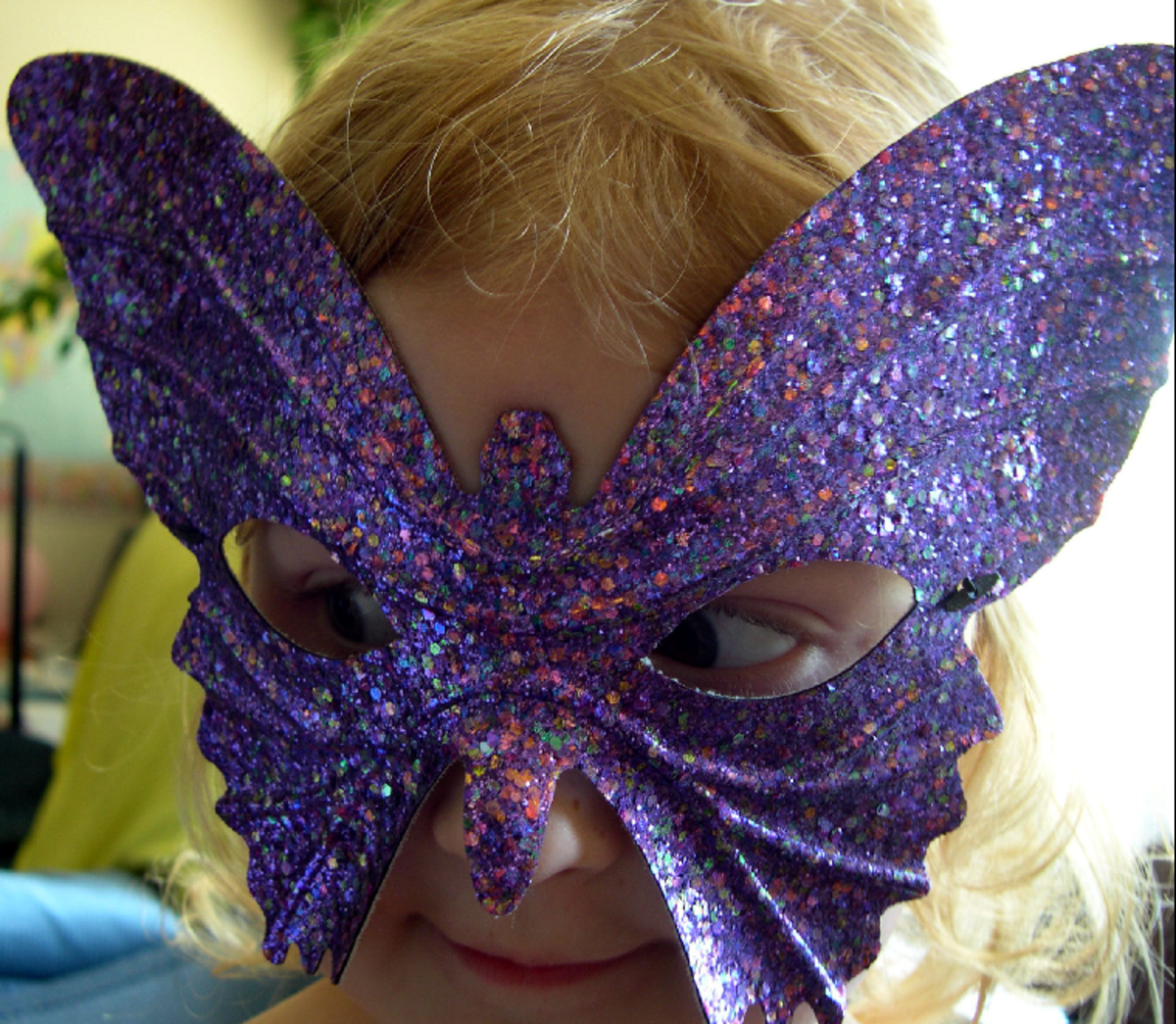 Little Girl with Butterfly Mask