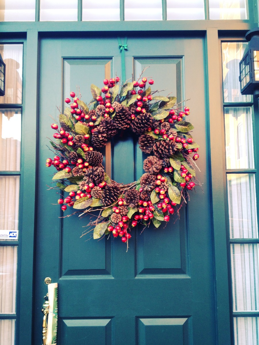 A berry wreath for the front door adds a festive touch and is perfect for holiday decor.