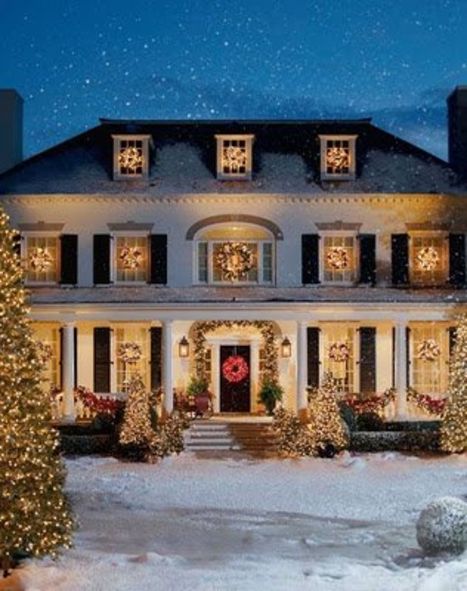 Holiday Wreaths on a Colonial Two-Story House