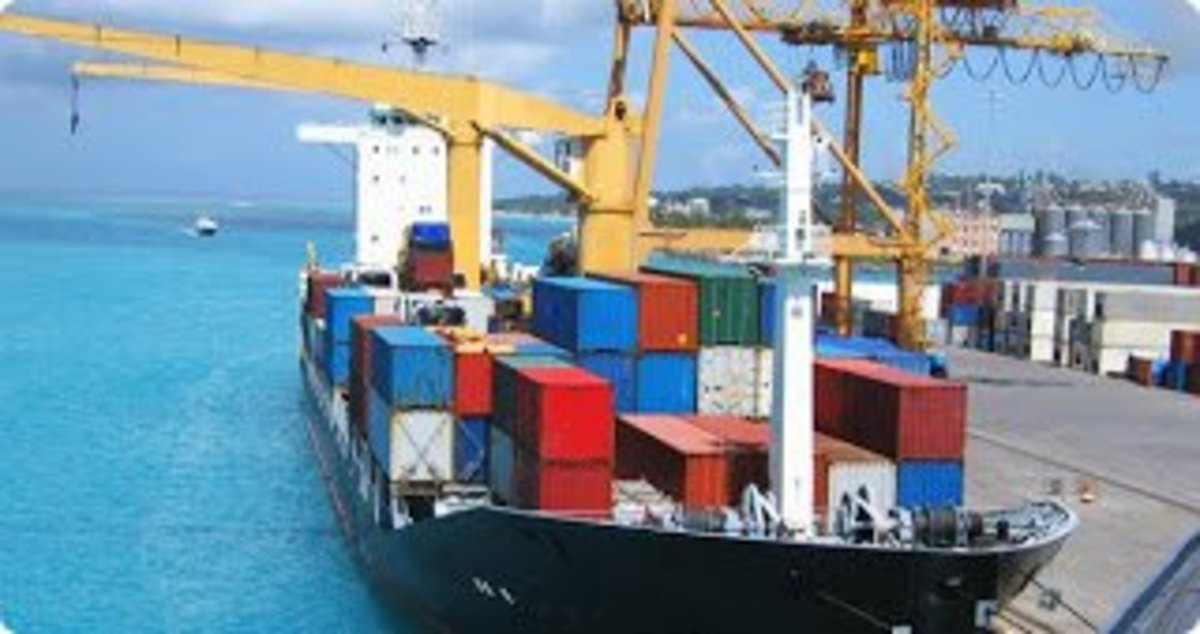 Here at port, your boxes inside the containers are being loaded aboard a ship.