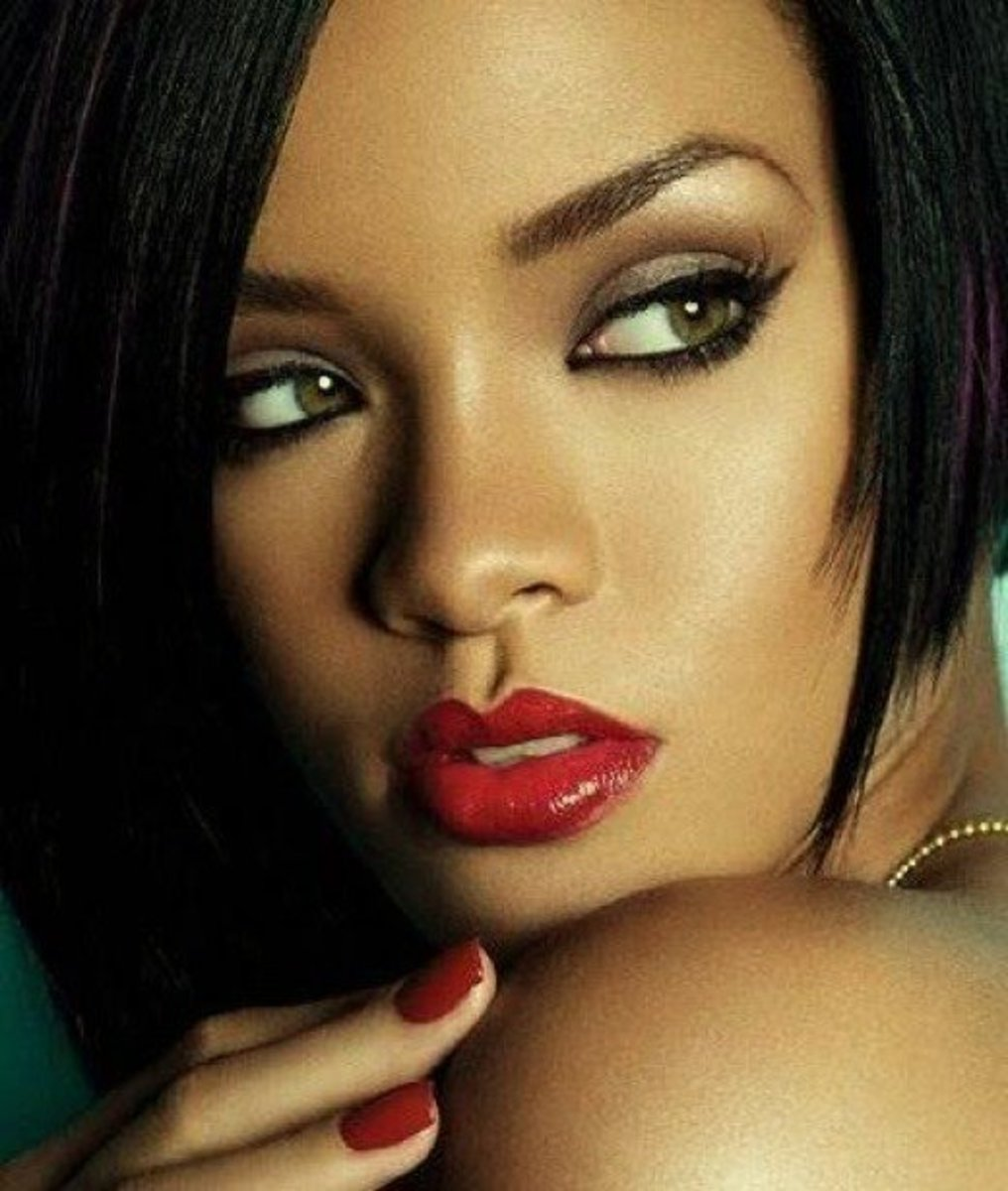 Rihanna with natural green eyes that look fabulous on her milk chocolate skin.