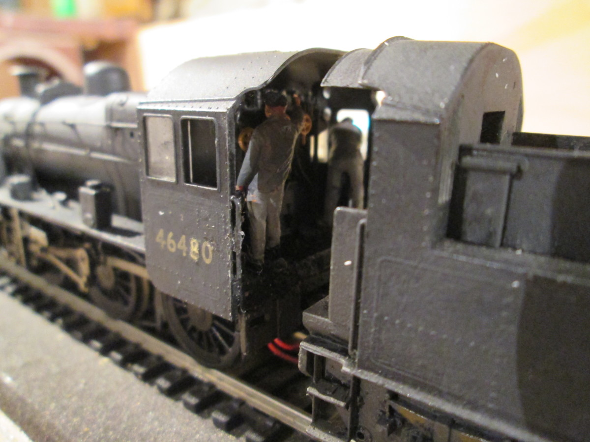 Cab view of 46480 (a Bachmann Branchlike model) shows driver on the left at the controls, fireman on the right looks out for signals the driver can't see on a right-hand curve