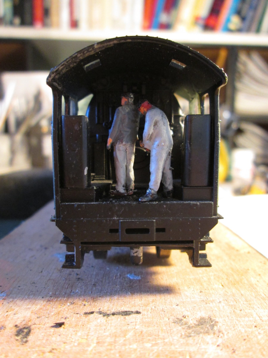 Crew positioned, driver to the left. Pre-LNER eastern English railway companies' locomotives were right-hand drive. North British engines were left-hand drive so LNER locomotives that ran in Scotland were refitted for left side drive.
