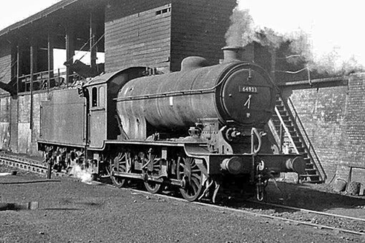 Darlington (51A) J39 rests at the coaling stage, also with 4200 gallon GST