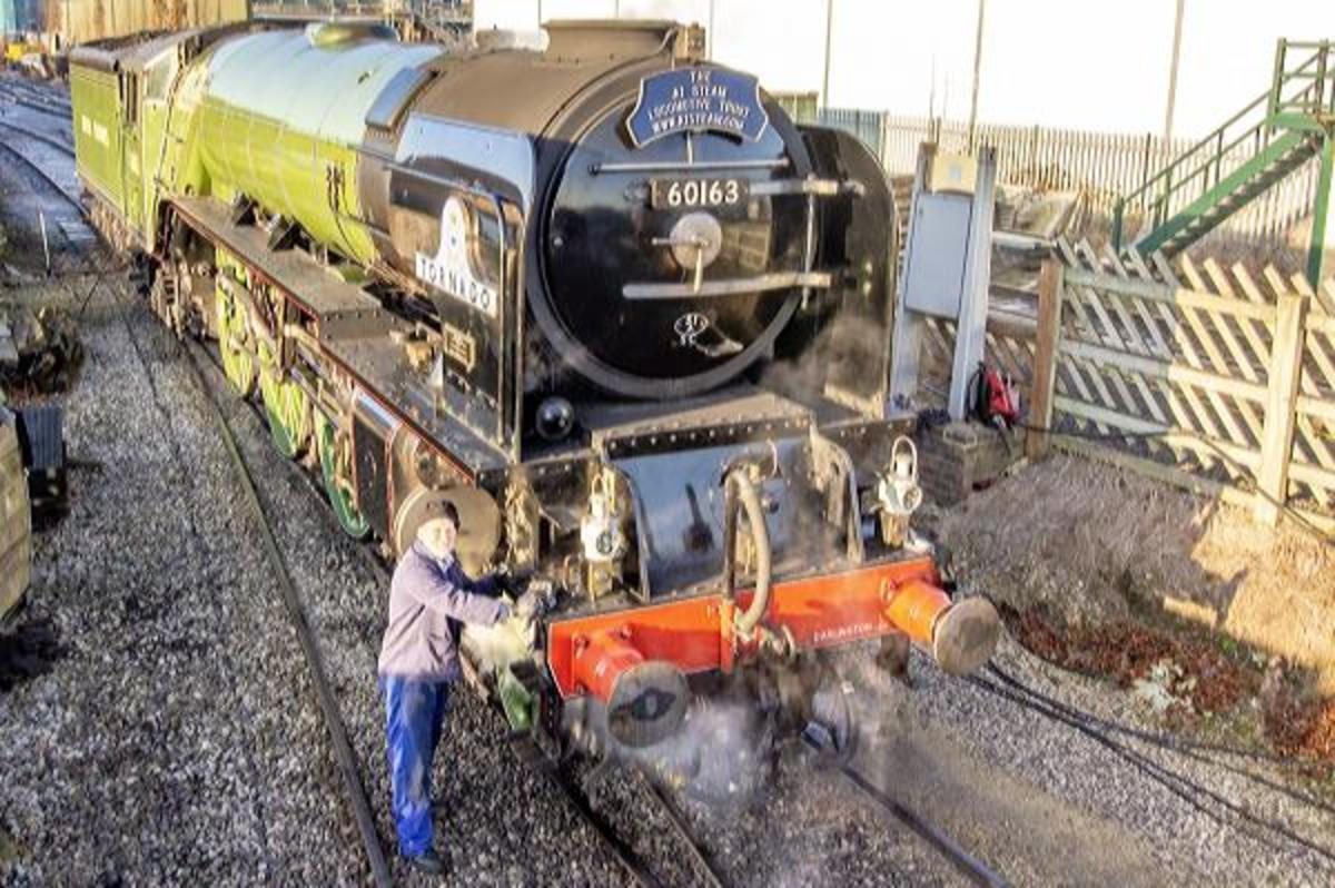 Here's an average fully grown man working on the engine to give you an idea of the size of these locomotives. At full speed it takes a couple of miles after applying the brakes to stop.