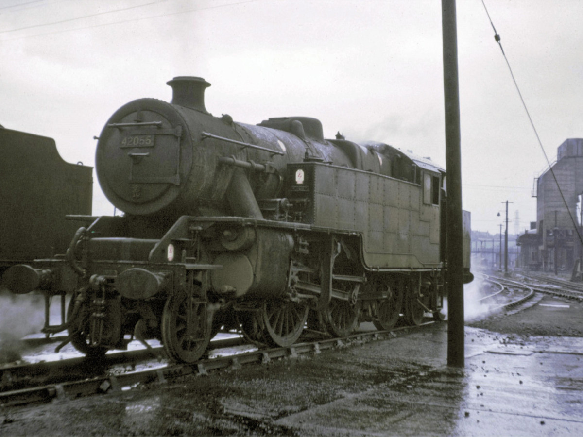 42055 stands in the rain at Low Moor shed near Bradford. An atmospheric shot of a redoubtable locomotive