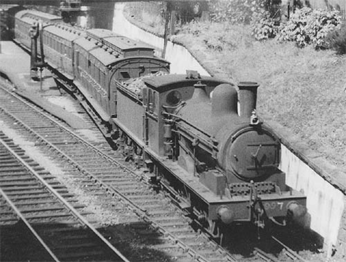With a fine rake of North Eastern vintage David Bain suburban clerestory stock, this is another LNER-numbered veteran, No. 997 at Beamish well before preservation days