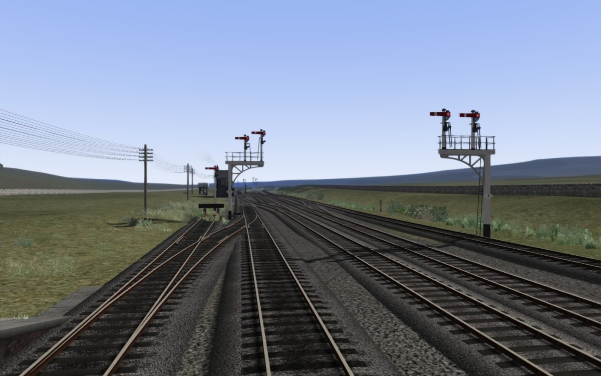 Bracket signals on a virtual reality display, 'Stainmore Route Project', recreating the route from Barnard Castle over the Pennines to Tebay. Stainmore Common was the highest point on Britain's railways