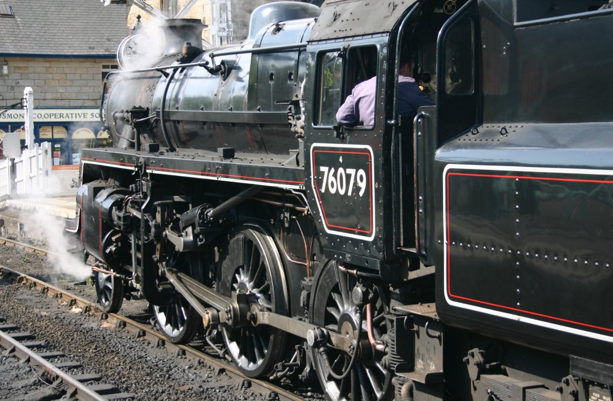 On the North Yorkshire Moors Railway at Grosmolnt with a train for Pickering, preserved 76079 simmers by the level crossing