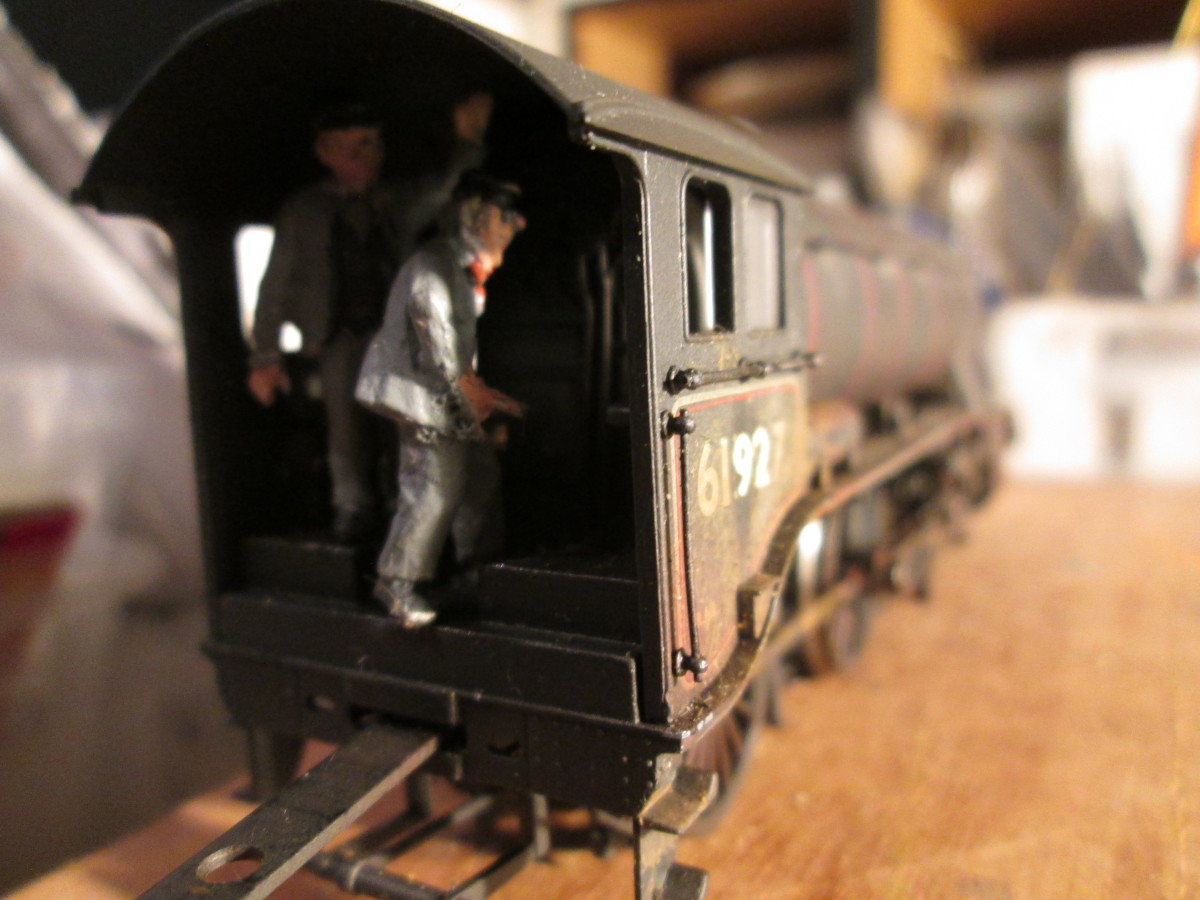 In the cab, the fireman busies himself with feeding the grate whilst the driver keeps a firm grip on the regulator