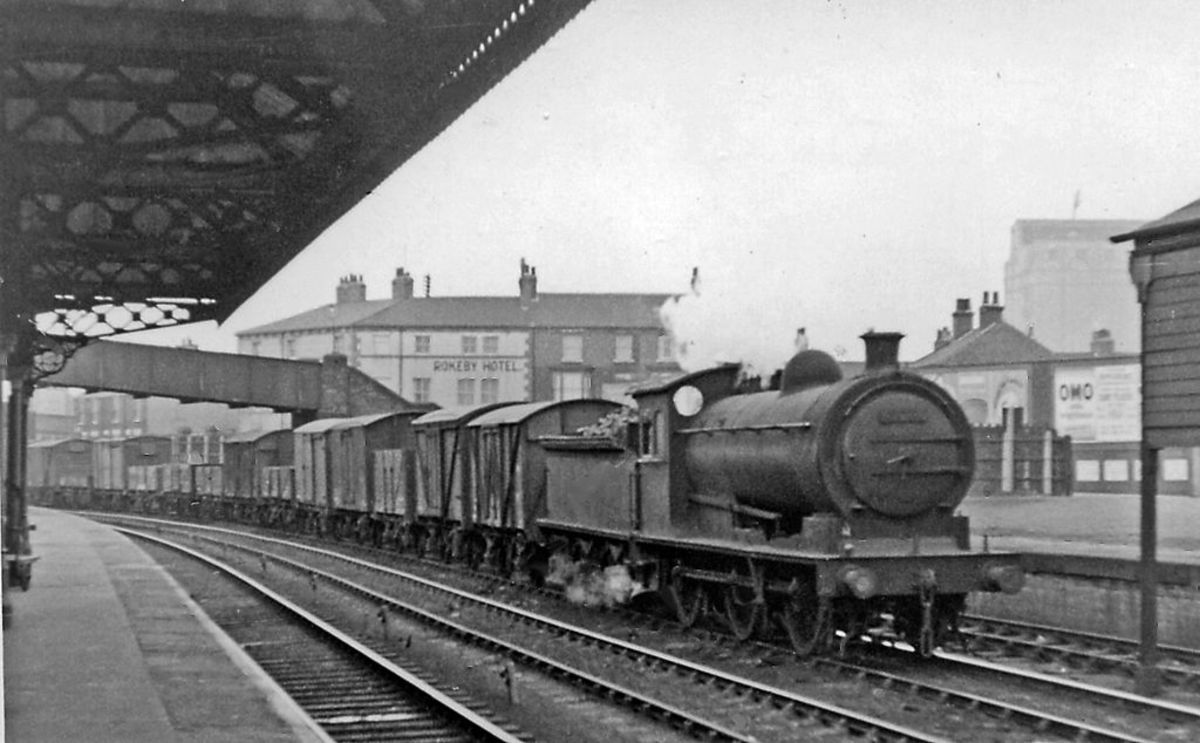 Class J26 65774 passes through Thornaby station in BR days with a long Down freight. In 1950 she was a Newport (51B) engine, transferred 1958 to the newly opened Thornaby (51L) shed, withdrawn before or by June, 1962