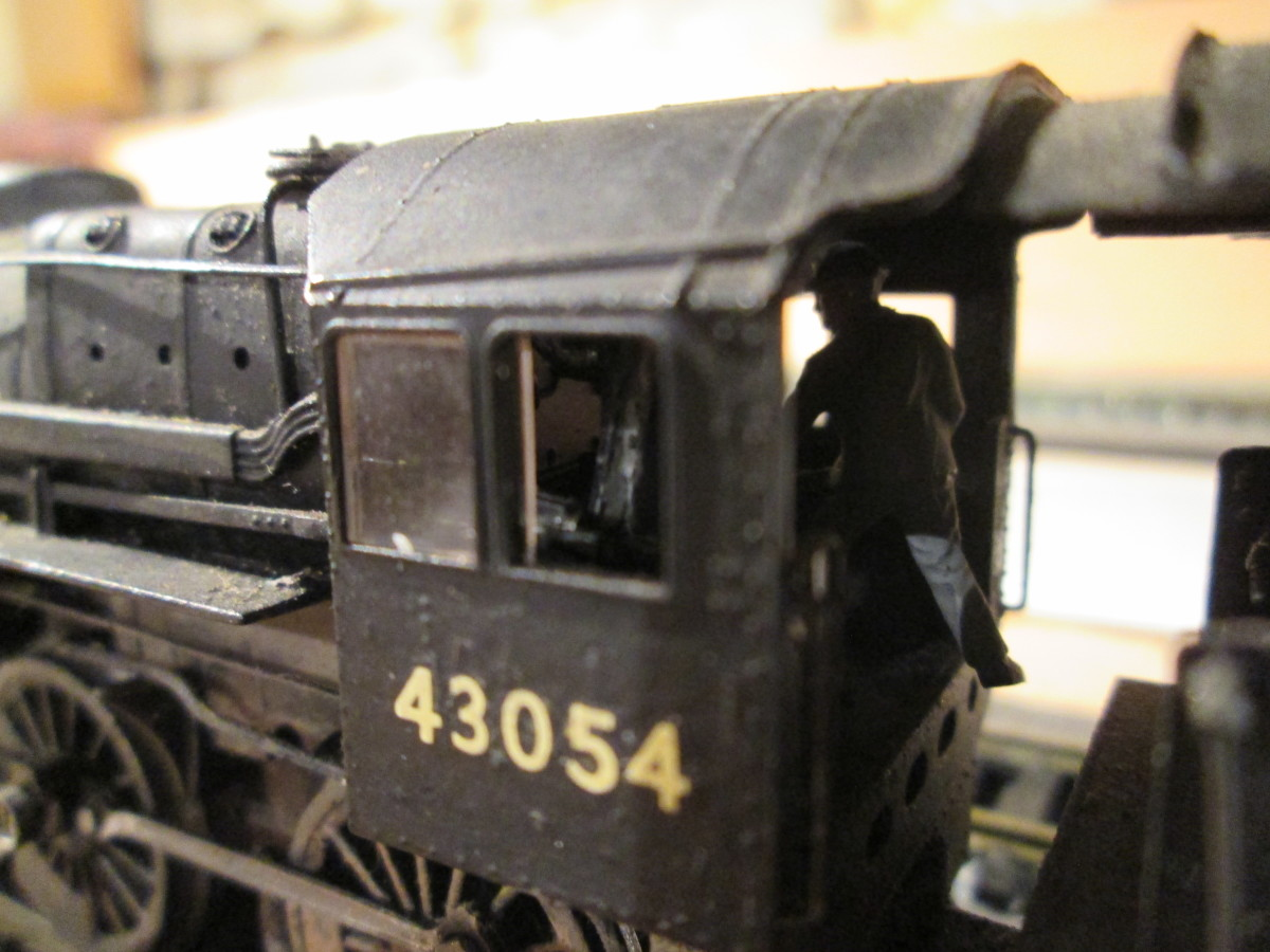 One for the rivet-counters: close-up of 43054's cab shows the fireman's busy building up her reserves before setting out. Driver's on the left, more or less invisible in this view