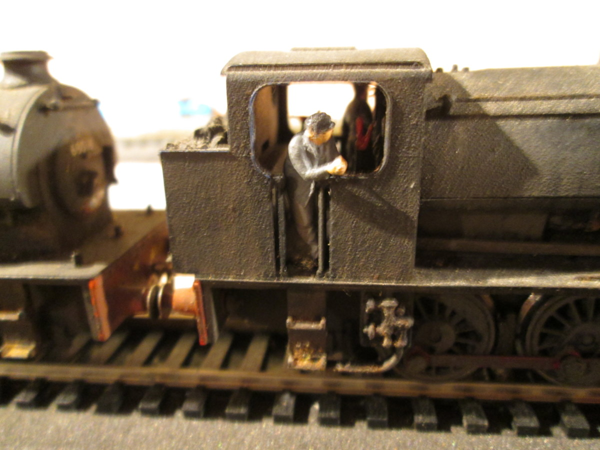 The fireman aboard an ex-WD Class 0-6-0 saddle tank (ST) J94 looks ahead for a signal at 'off' - hand-painted ModelU figure (I paint my own although the service is offered).