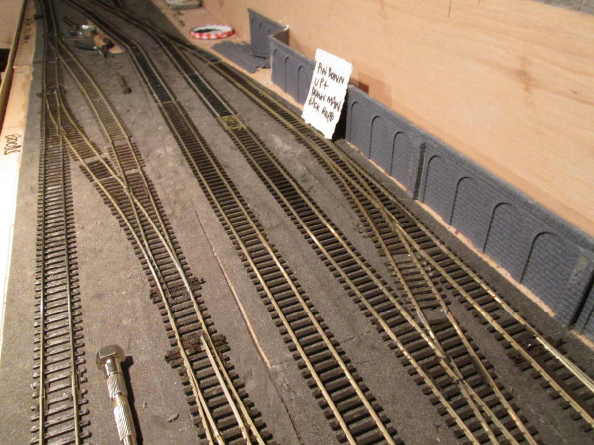 Unit 5 trackwork has been rationalised, the (defective) three way and single slip have been lifted to make way for medium radius left and right-hand points respectively, access to the Down Main still possible for the banker