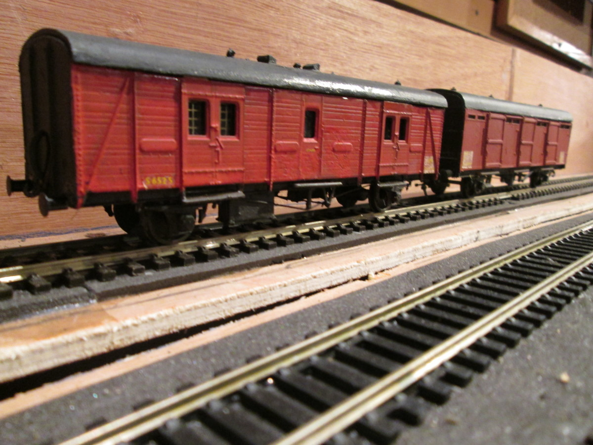 A Southern Region GUV (utility van) in early BR livery, and an ex-LNER CCT  (covered carriage truck) on parcels duty by this time.(Parkside kits)