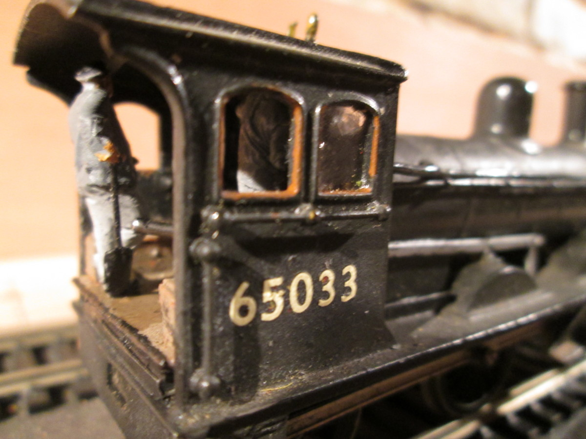 ...And in close-up of the cab. The driver (on this side,  lost in shadow) has a hand on the regulator as he looks through his 'porthole' for signals. The fireman to his left nonchalantly takes a breather from topping up the grate.