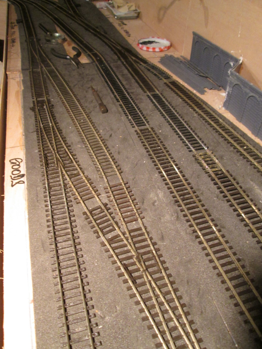 Further along, the double slip has made way for a pair of left-hand points, a 'loop' created for locos to pass in the yard if necessary. Spare sleepers to fill gaps.