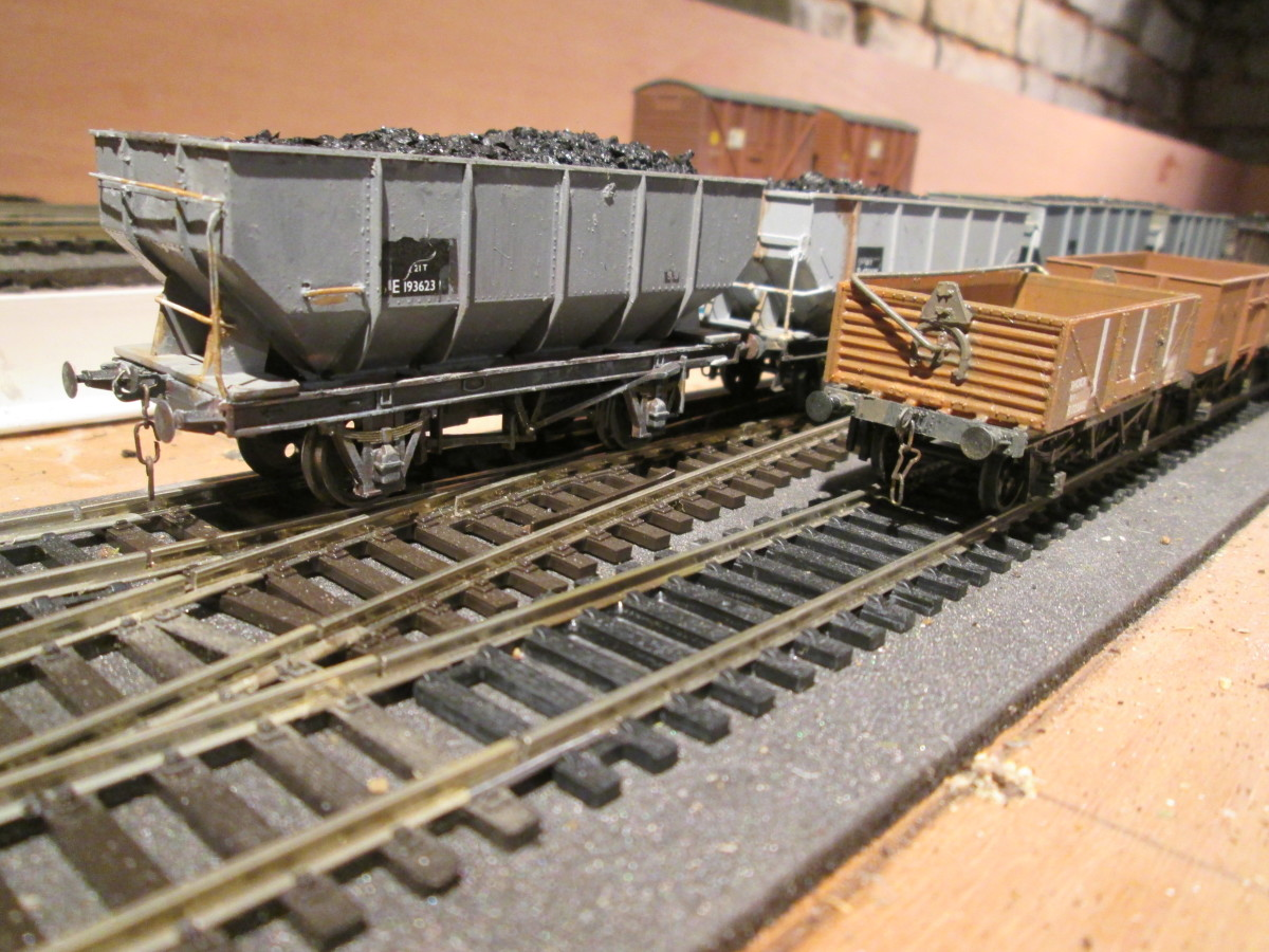 """Leading wagons,, ex-LNER steel mineral hopper (modified Dapol), and a Parkside BR 'shocwagon' for fragile consignments - the Dapol hopper wagon is a subject of ROPFAMR - 32 """"Convert a Proprietary Hopper... """" Behind it is the Parkside Dgm 1/146 hoppe"""