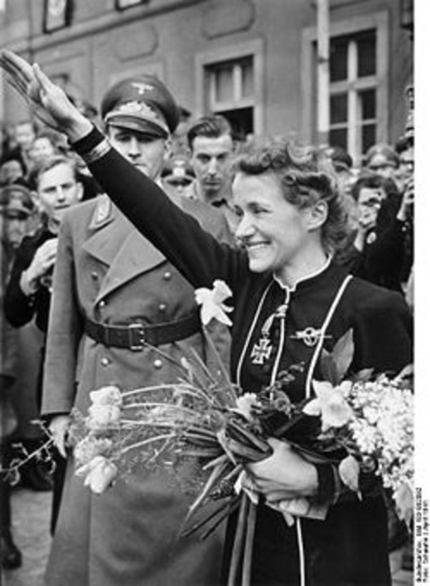 Hanna Reitsch greets well-wishers on a visit to her hometown of Hirschberg, Silesia in April, 1941. Karl Hanke, Gauleiter of Lower Silesia, is at lef