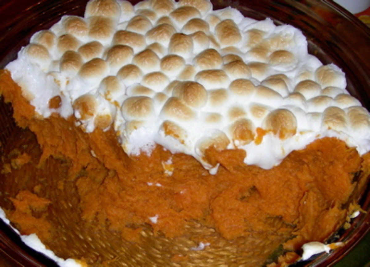 Oh man I love Candied Sweet Potatoes With Marshmallows