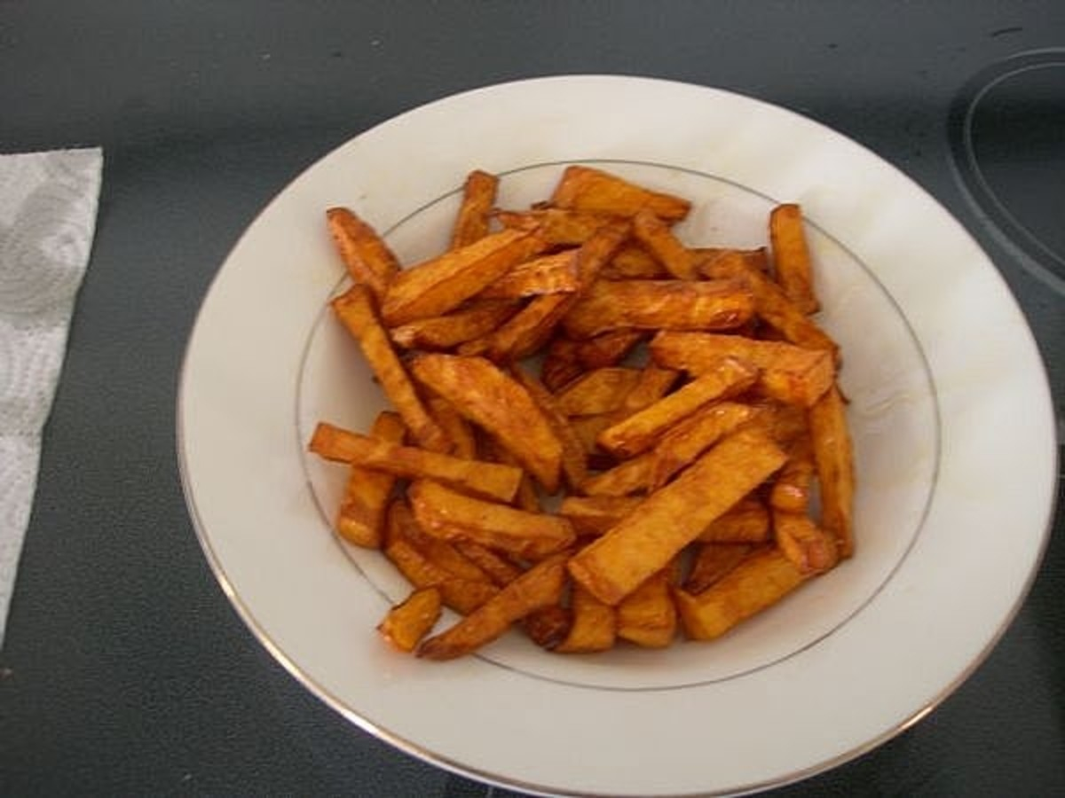 Pour your sweet potato fries into a large bowl and sprinkle with honey and granulated sugar.