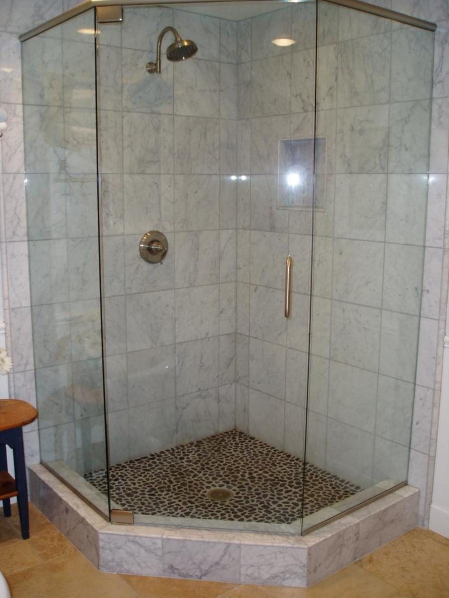 A small bathroom shower or corner shower with clear doors will make small bathrooms look larger.