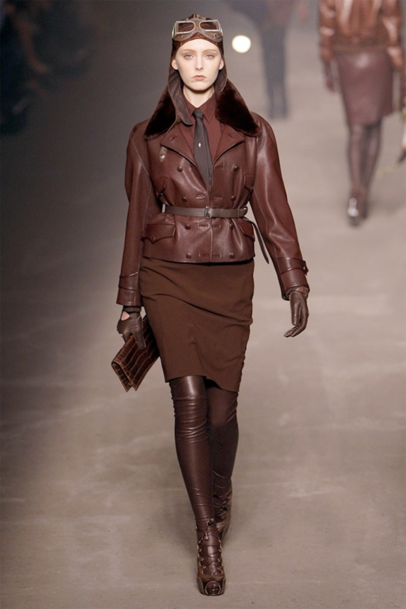 Lady Aviator Look - Note the high boots, the blends of chocolate brown and the masculine tie