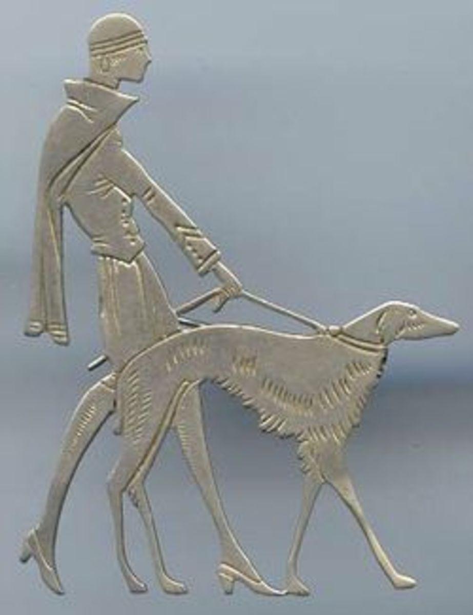 Brooch. Classic Art Deco motif...an elegant woman walking a dog.