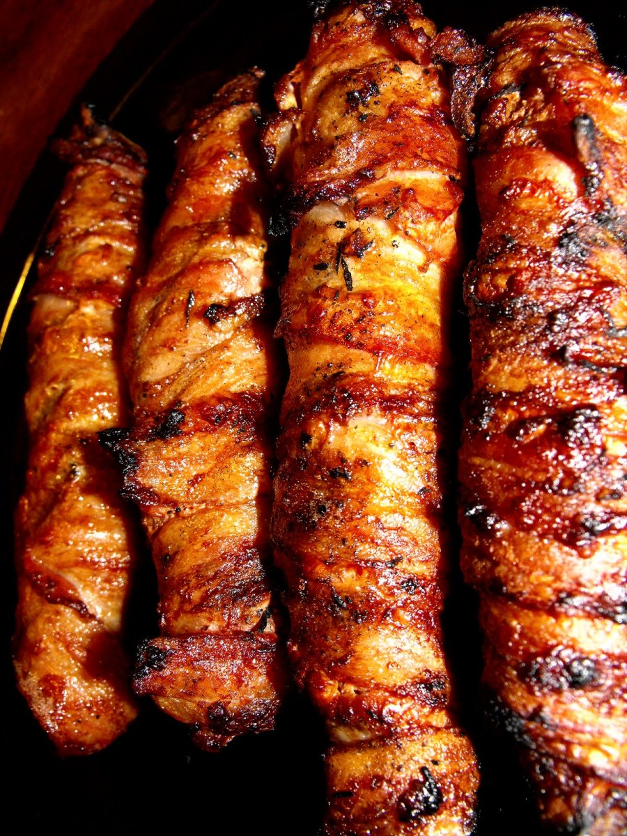 In this photo you have delicious Bacon Burger Dogs that have been grilled. And in case you're wondering yes they are delicious. Have you ever had one. They are easy to make and they are delicious.