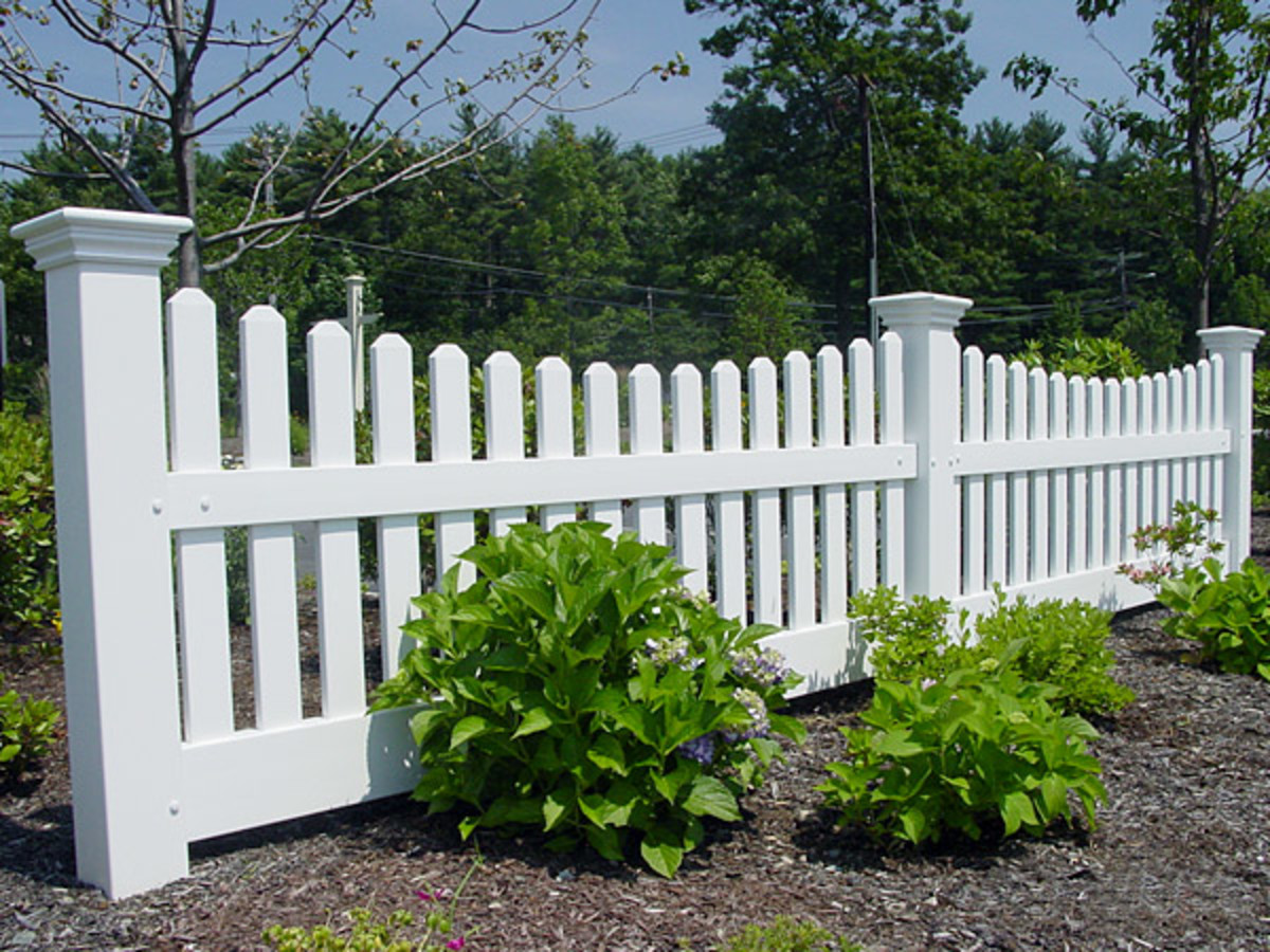 white picket fence with a scalloped design