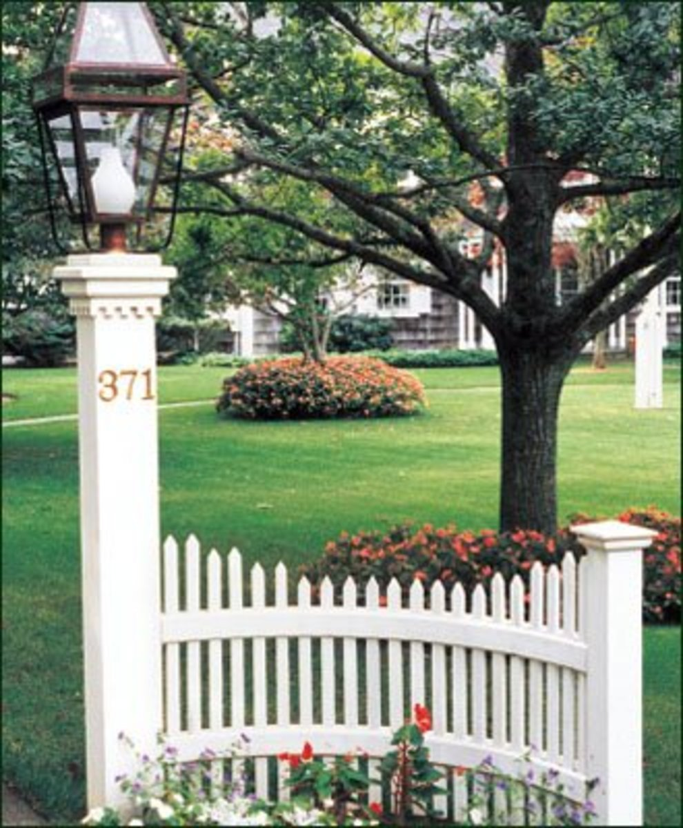 walpolewoodworkers.com white picket fence with lampost