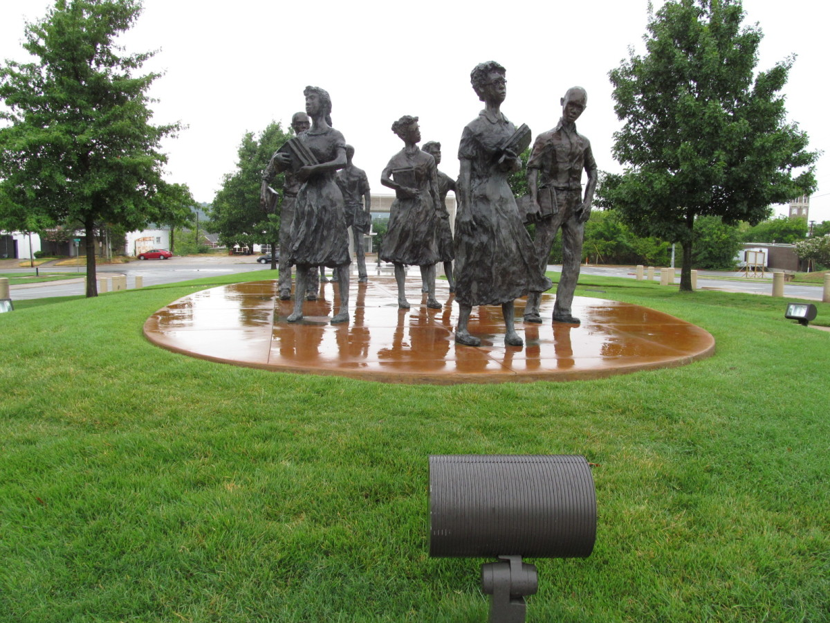The Little Rock Nine, the first African American children to attend Central High School. They were accompanied by the National Guard.
