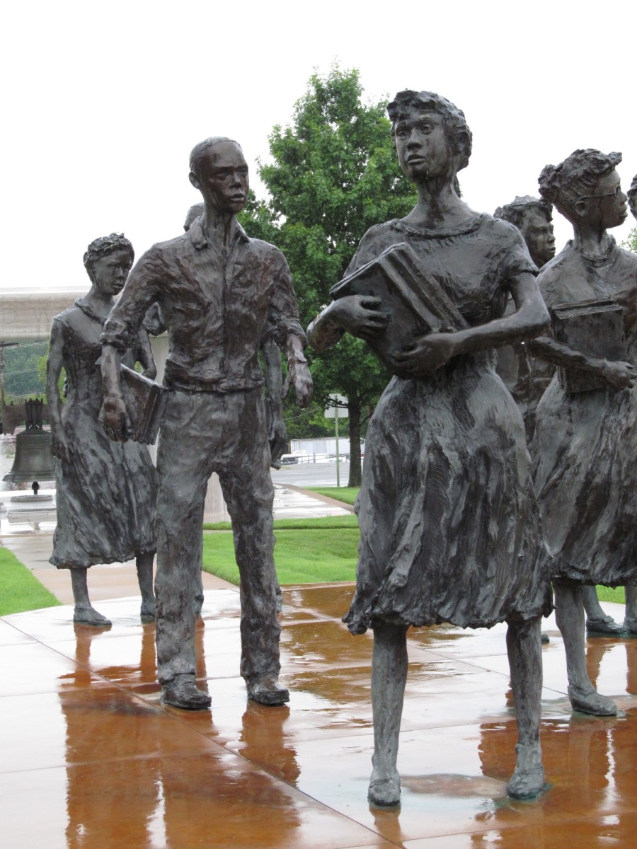 The Little Rock Nine by John Derring weather the storm, as a Liberty Bell remains covered with expensive marble - In God We Trust...
