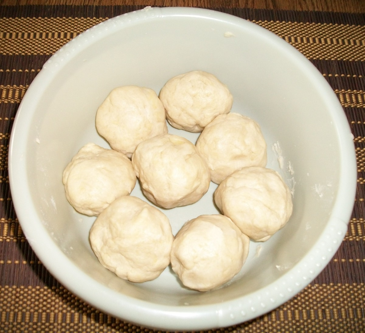 Knead the dough until elastic and divide into 8 balls.