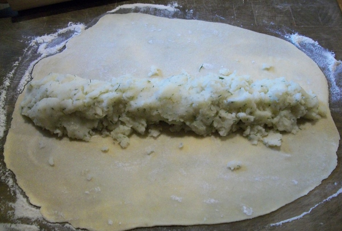 Put mashed potatoes in the middle. Roll dough over the filling.
