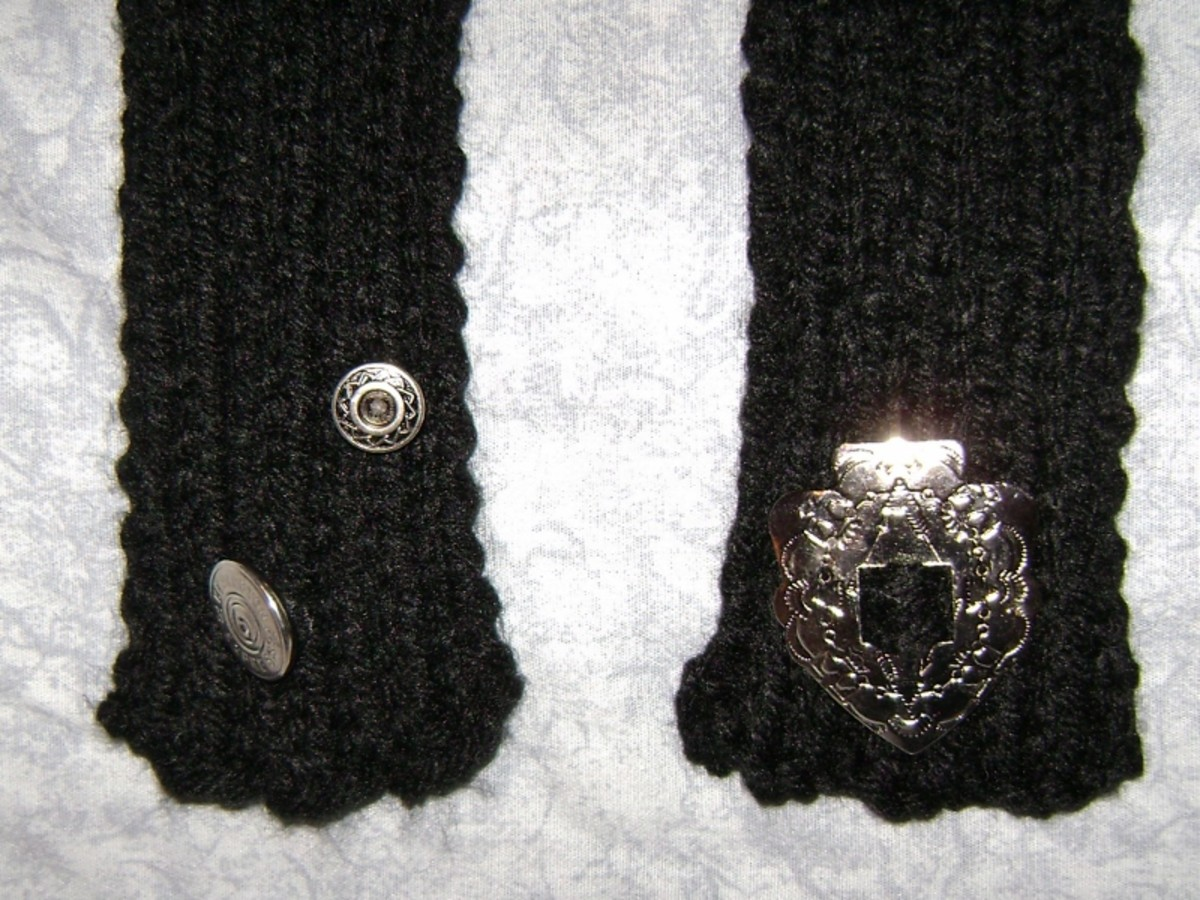 I used some of my silver buttons on this black scarf I knit.