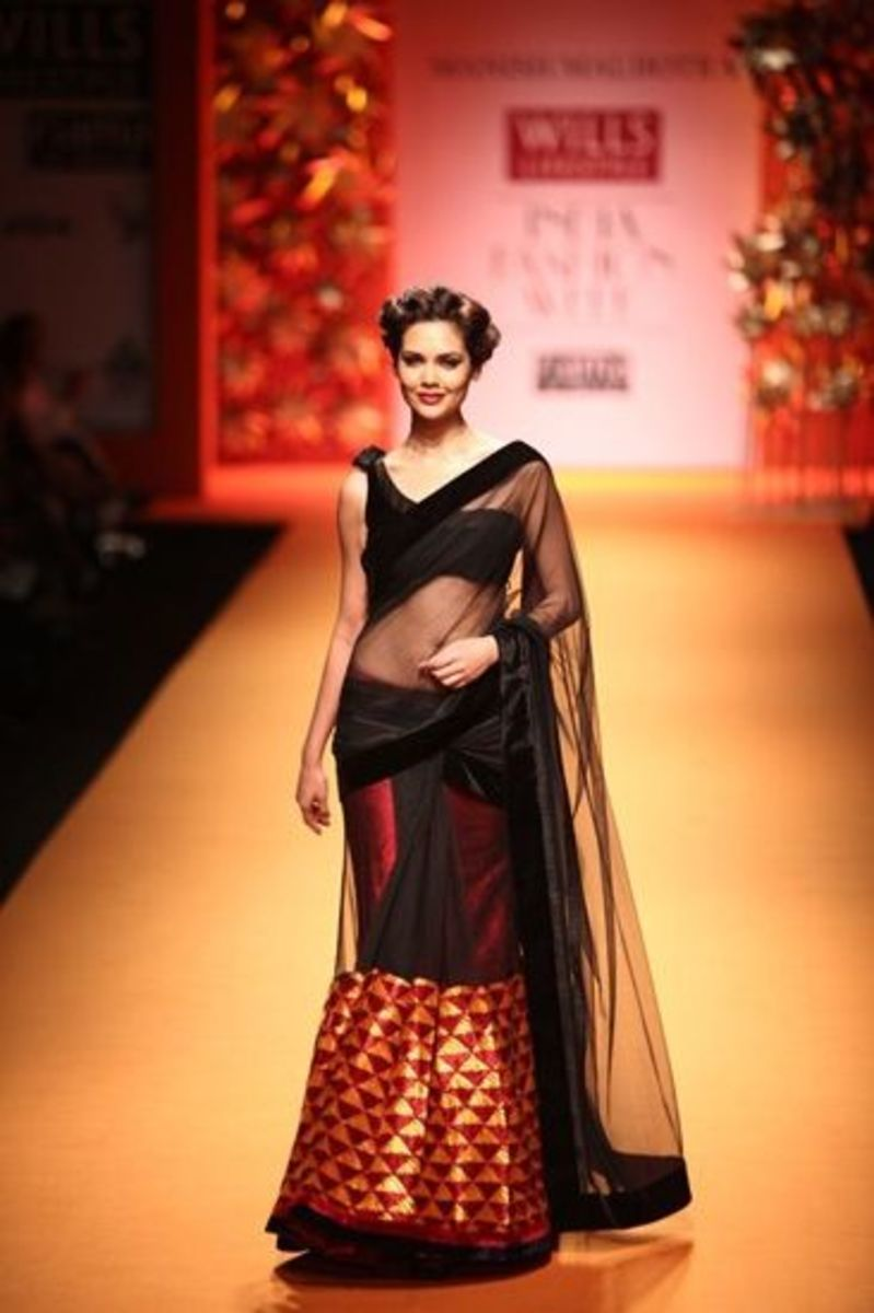 One-shoulder style black velvet saree blouse.