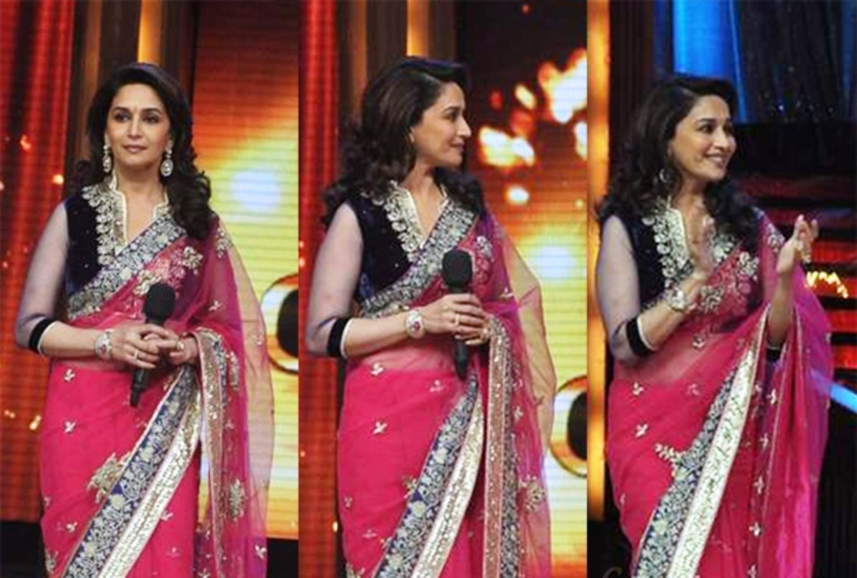 Madhuri Dixit in navy blue velvet saree blouse with chiffon sleeves, worn with a hot pink saree