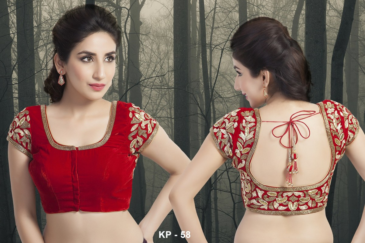 Embroidered red saree blouse.