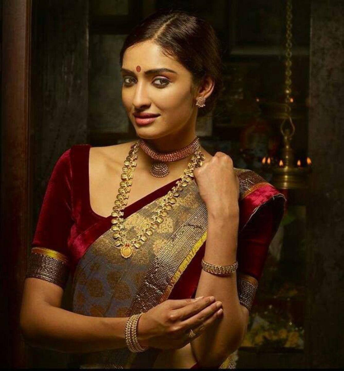 A deep maroon half-sleeve saree blouse style.