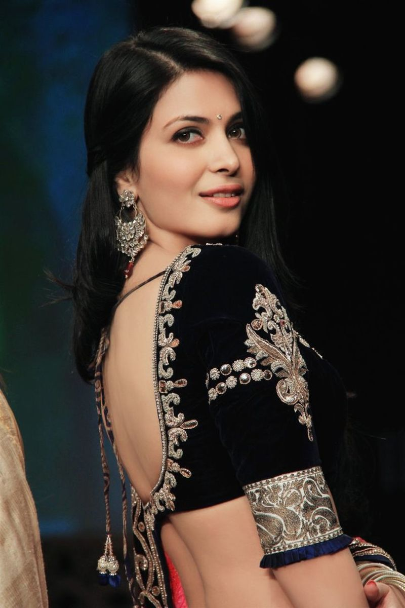 Super-gorgeous black velvet saree blouse with big U-shaped back and embroidery.
