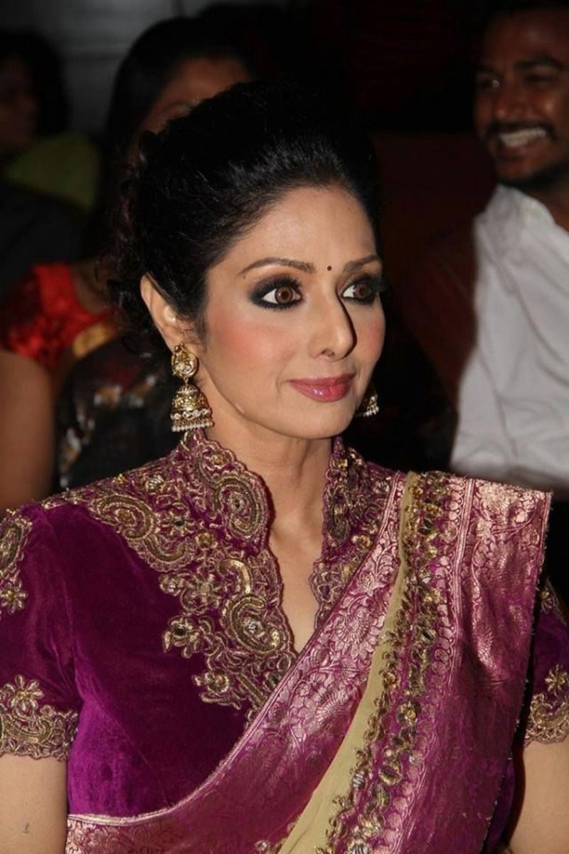 Sridevi in Purple regal saree blouse with high neck style and gold embroidery around the neck and sleeves