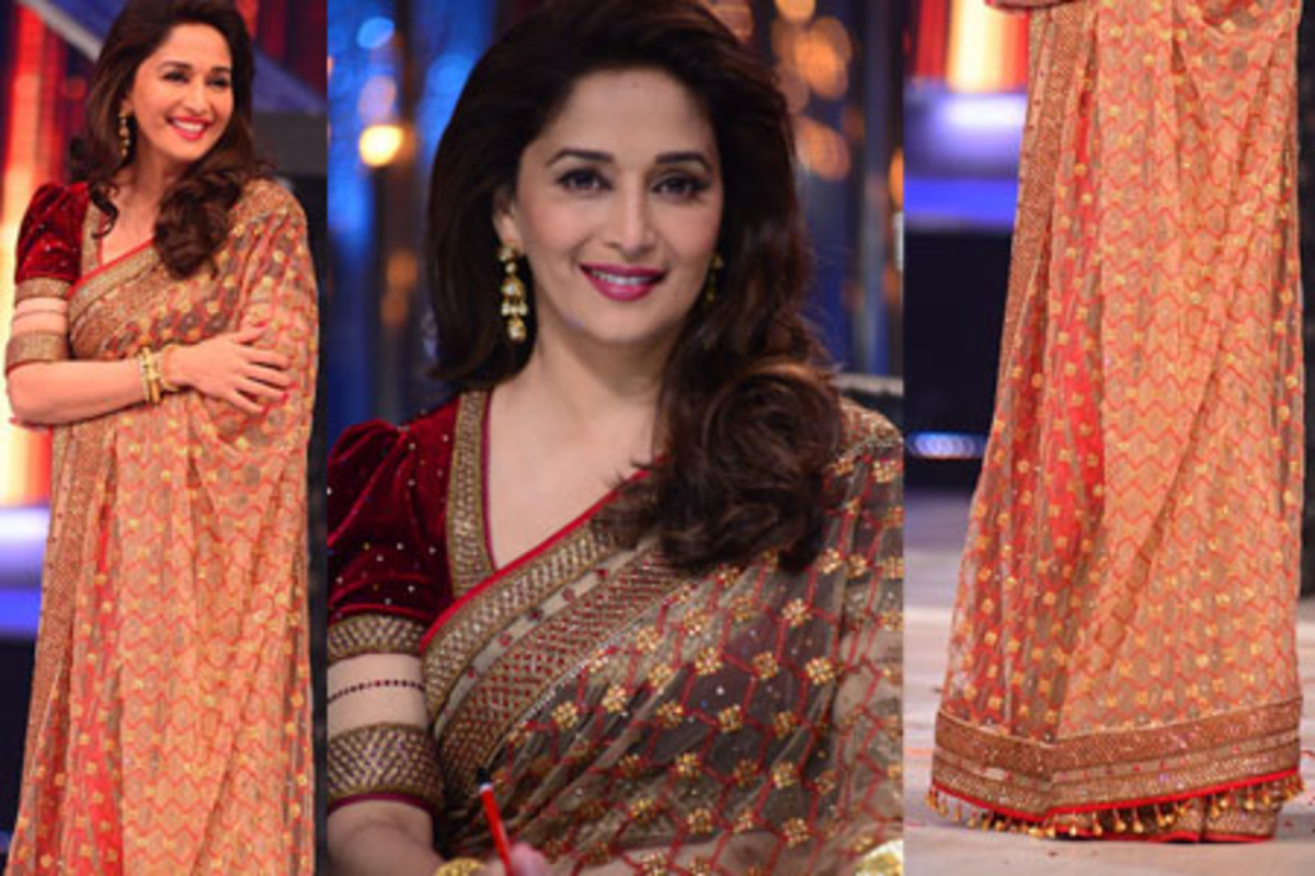 Madhuri Dixit in a gorgeous deep maroon saree blouse.