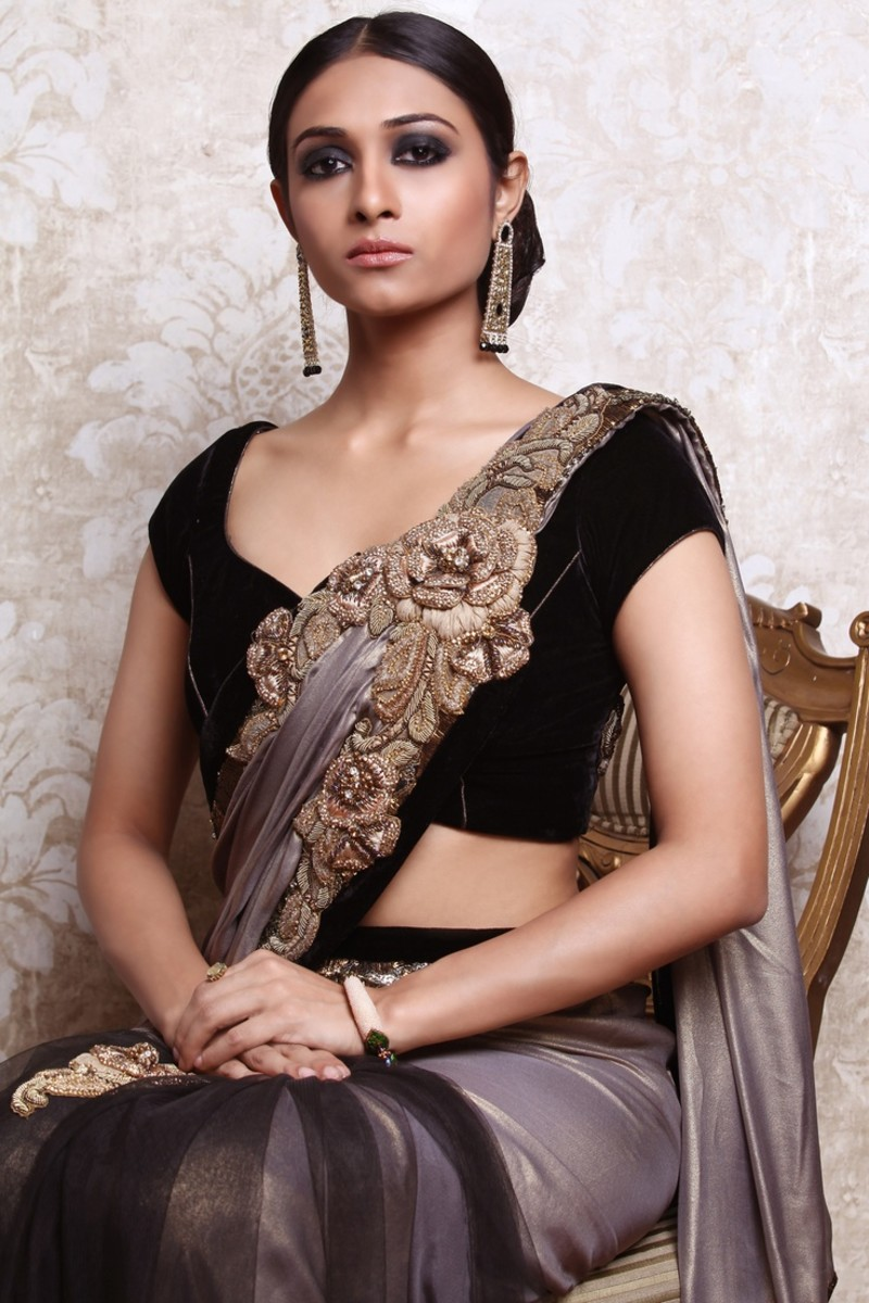 A simple cap-sleeved saree blouse of velvet material
