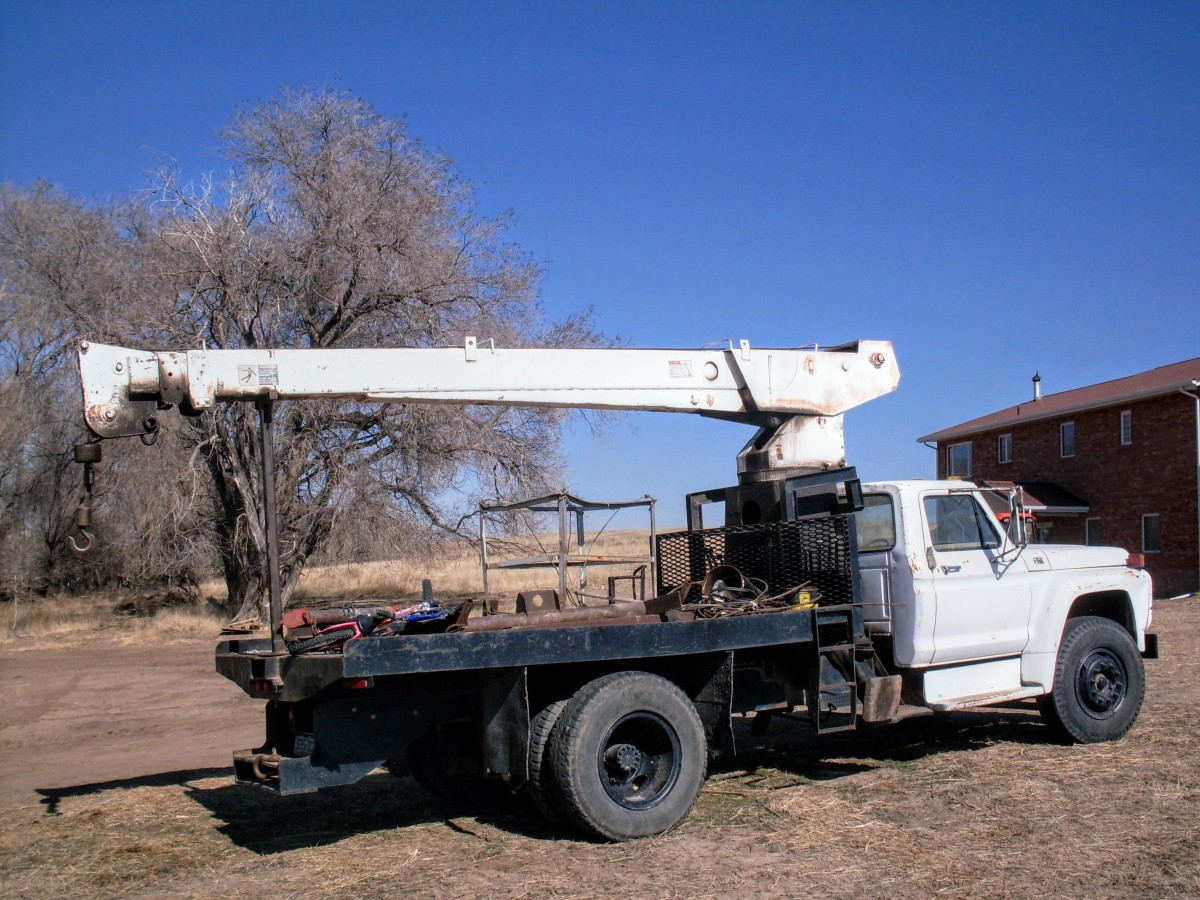 This boom truck belonged to a friend, and was our work partner for several years. It helped move, tear down and set up many grain bins.