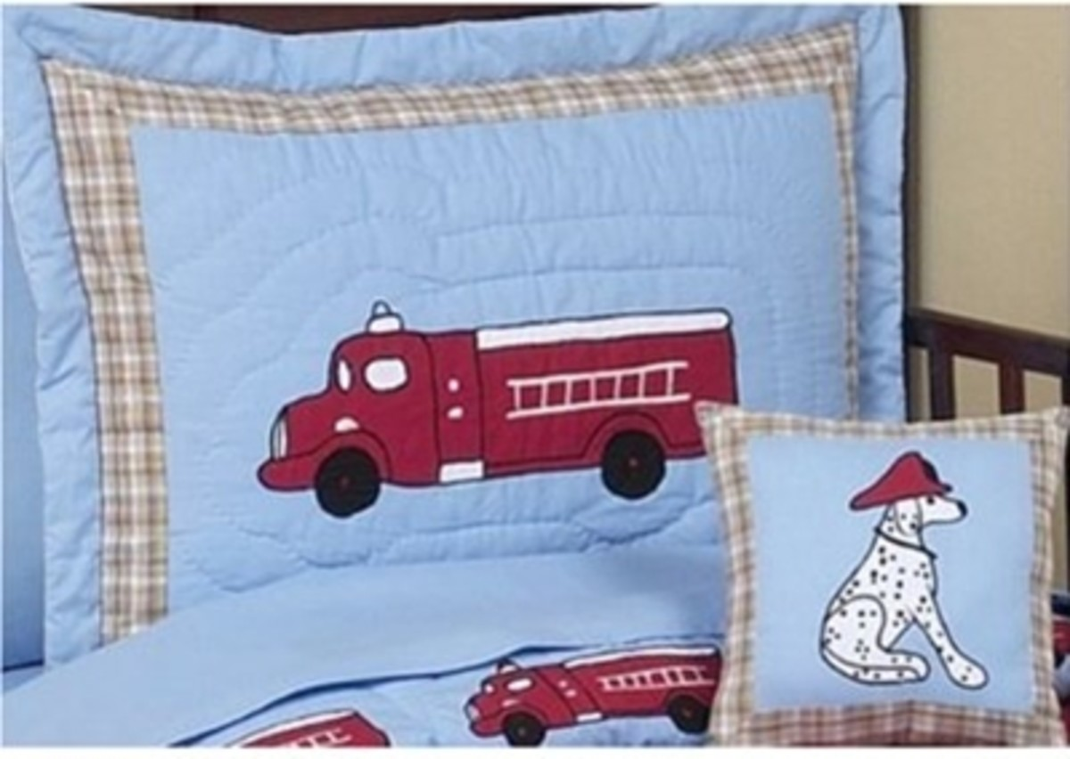 This great fire truck bedding set includes a toddler comforter quilt measuring 48 x 60, one standard pillow sham 20 x 26, one standard pillowcase, one flat sheet and one fitted sheet.  Beautiful appliques.  (Use link below to go to product page).