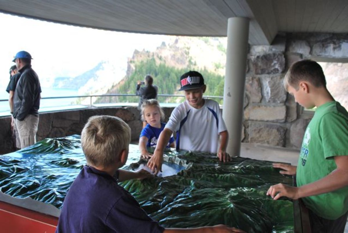 Children work with a model of Crater Lake